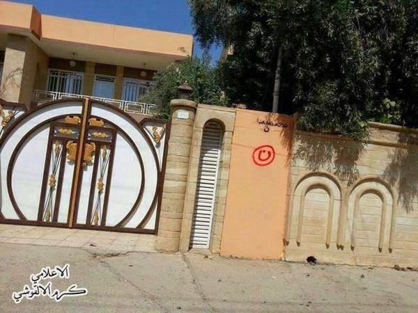 "A Christian home marked with ""Nun"", indicating that the inhabitants are to be killed (or taken as sex slaves) and the property appropriated for the Caliphate."