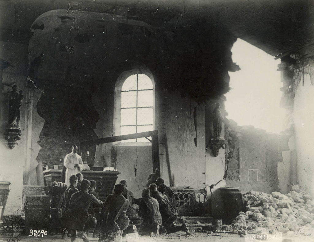 French soldiers assisting at the Holy Sacrifice of the Mass in an unknown chapel.
