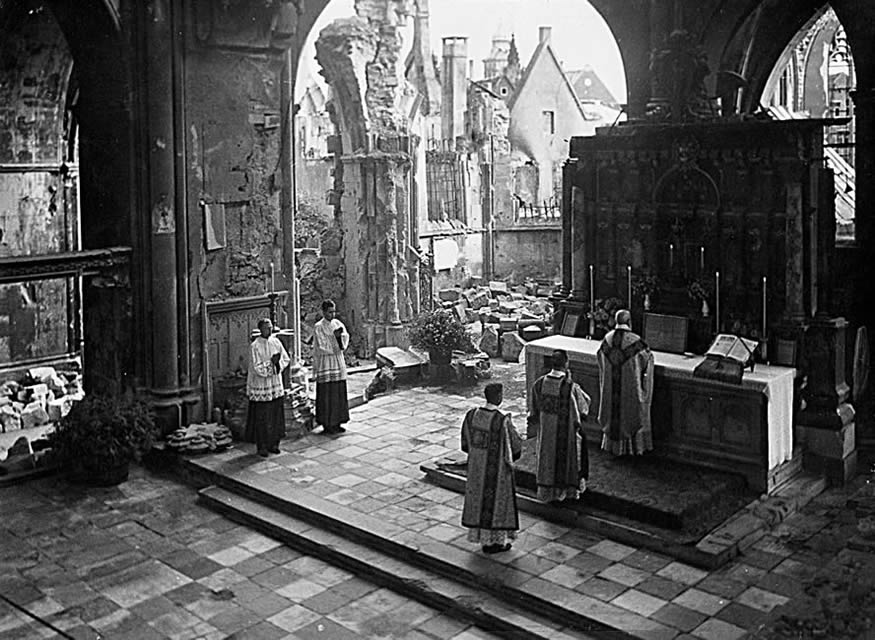 The Holy and August Sacrifice of the Mass in the Venerable Gregorian Rite, being offered at St. Paul's Cathedral, Munster, Germany, ARSH 1946. Perhaps someday we will live in a world in which the Church is as strong, healthy and resplendent as it was in this photograph.